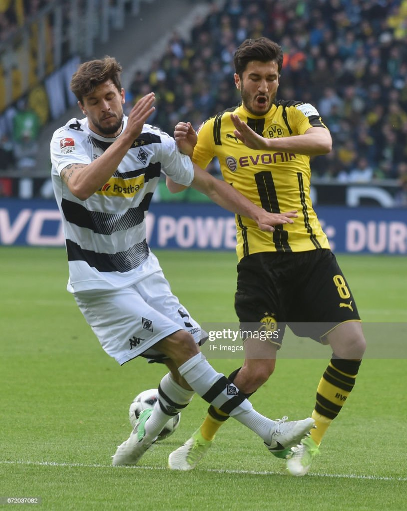 Nuri Sahin of Dortmund got injured after getting fouled by Tobias Strobl of Moenchengladbach during the Bundesliga match between Borussia Moenchengladbach and Borussia Dortmund at Borussia-Park on April 22, 2017 in Moenchengladbach, Germany.