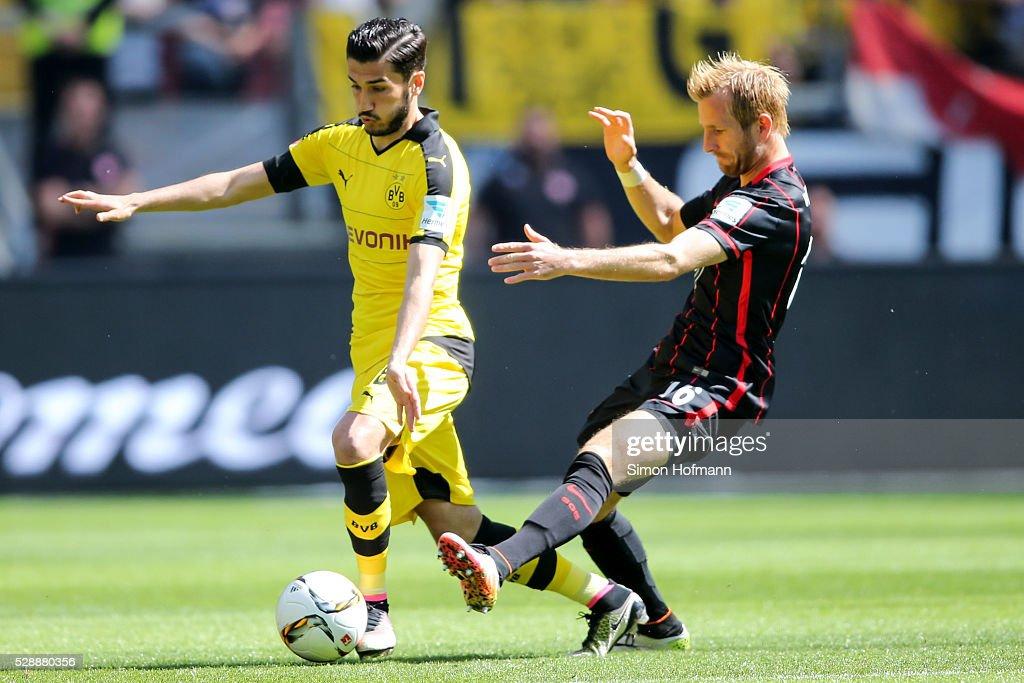 Nuri Sahin of Dortmund is challenged by Stefan Aigner of Frankfurt during the Bundesliga match between Eintracht Frankfurt and Borussia Dortmund at Commerzbank-Arena on May 07, 2016 in Frankfurt am Main.