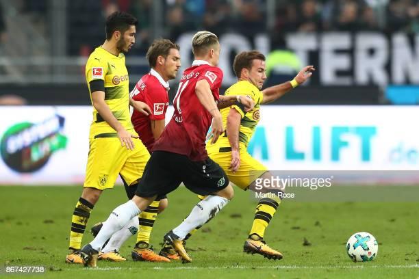 Nuri Sahin of Dortmund Oliver Sorg of Hannover Felix Klaus of Hannover and Mario Goetze of Dortmund fight for the ball during the Bundesliga match...