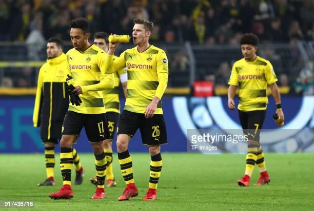 Nuri Sahin of Dortmund PierreEmerick Aubameyang of Dortmund Lukasz Piszczek of Dortmund and Jadon Malik Sancho of Dortmund look dejected after the...