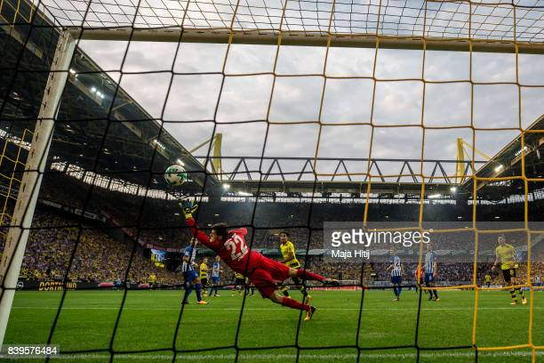 Nuri Sahin of Dortmund scores his team's second goal against Rune Jarstein goalkeeper of Hertha to make it 20 during the Bundesliga match between...