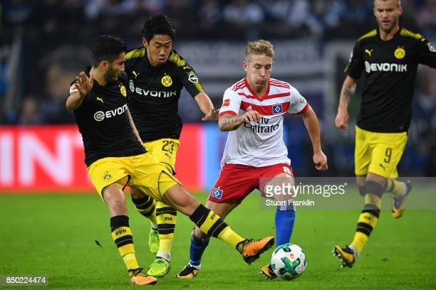 Nuri Sahin of Dortmund Shinji Kagawa of Dortmund Lewis Holtby of Hamburg fight for the ball during the Bundesliga match between Hamburger SV and...