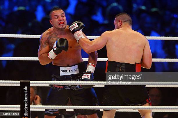 Nuri Seferi of Siwtzerland punches Giulian Ilie of Italy during the cruiserweight fight between Nuri Seferi of Switzerland and Giulian Ilie of Italy...