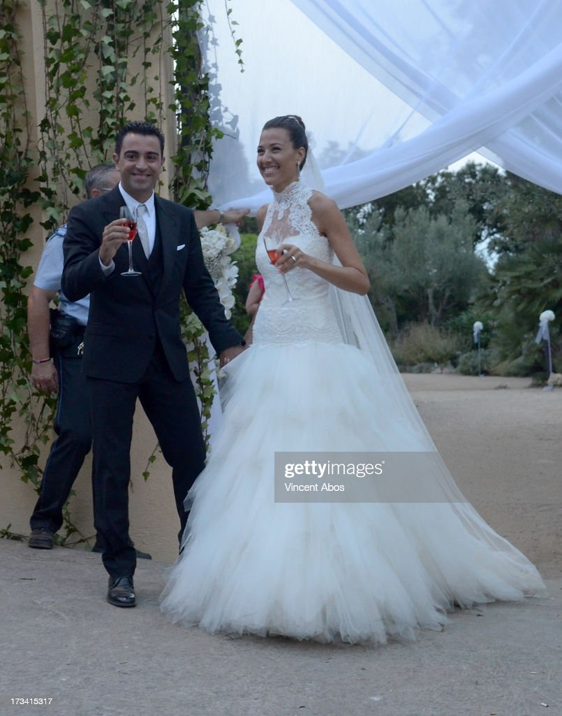 Nuria Canillera and Xavi Hernandez pose for the press after their wedding at the Marimurtra Botanical Gardens on July 13, 2013 in Barcelona, Spain.