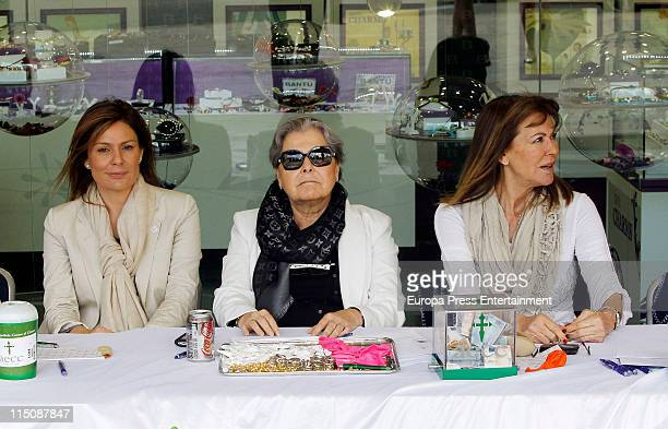 Nuria Gonzalez Mari Angeles Sandoval and Paquita Torres preside the Real Madrid Cancer Charity Table to collect funds for the Spanish Cancer...