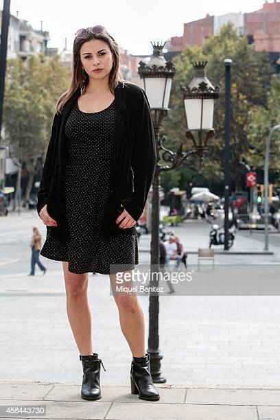 Nuria is wearing a HM polka dot dress a Bershka jacket Stradivarius shoes Falco sunglasses and jewelry from different markets in London Amsterdam and...