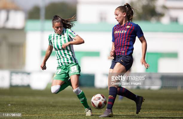 Nuria Ligero of Real Betis competes for the ball with Lieke Martens of FC Barcelona during the La Liga Iberdrola first division match between Real...