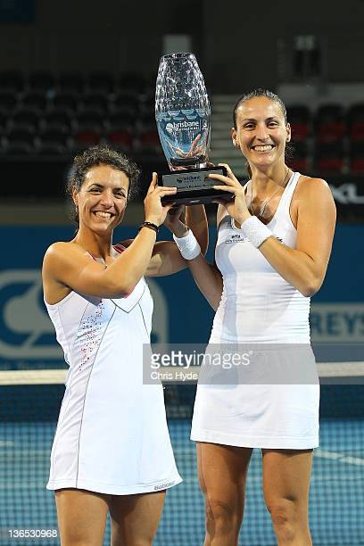 Nuria Llagostera Vines and Arantxa Parra Santonja of hold the winners trophy after winning the Womens doubles final during day seven of the 2012...