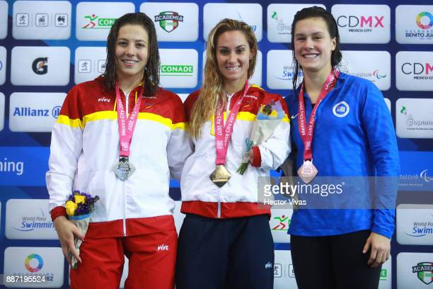 Nuria Marques of Spain silver medal Sarai Gascon of Spain gold medal and Natalie Sims of united States bronze medal in Women's 100 m Freestyle S9...