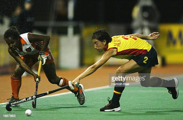Nuria Moreno for Spain contests with Maartje Scheepstra for the Netherlands during Women's World Cup Hockey match between Spain and the Netherlands...