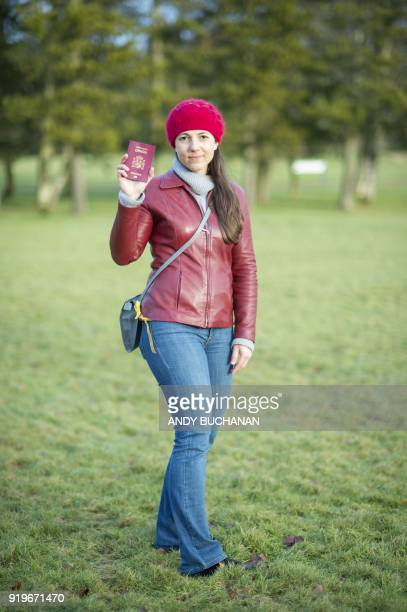 Nuria Orduna a senior design engineer from Barcelona living in Edinburgh Scotland poses with her passport in Glasgow on January 16 2018 On Brexit she...