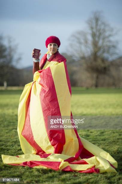 Nuria Orduna a senior design engineer from Barcelona living in Edinburgh Scotland poses with her passport while draped in the Catalan flag in Glasgow...