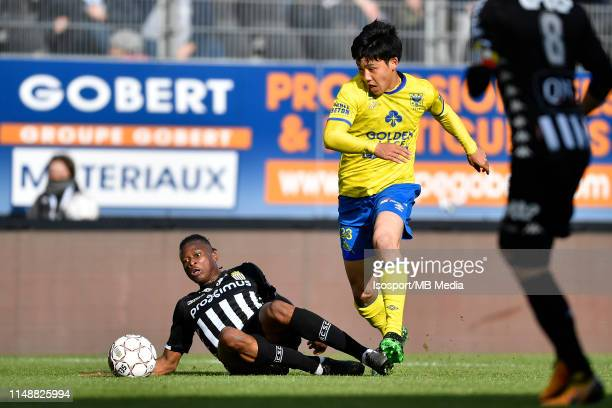 Nurio Fortuna of Charleroi and Wataru Endo of STVV fight for the ball during the Jupiler Pro League playoff 2 group A match between Sporting...