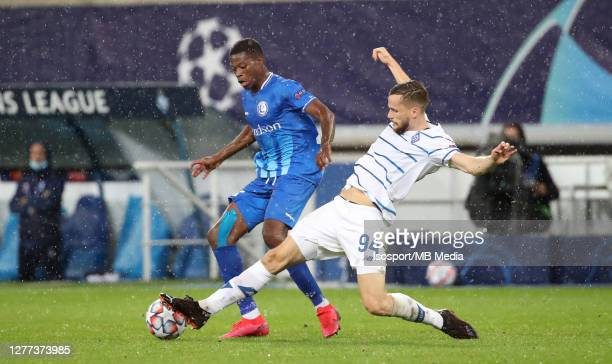 Nurio Fortuna of KAA Gent battles for the ball with Tomasz Kedziora of Kyiv during the UEFA Champions League PlayOff first leg match between KAA Gent...