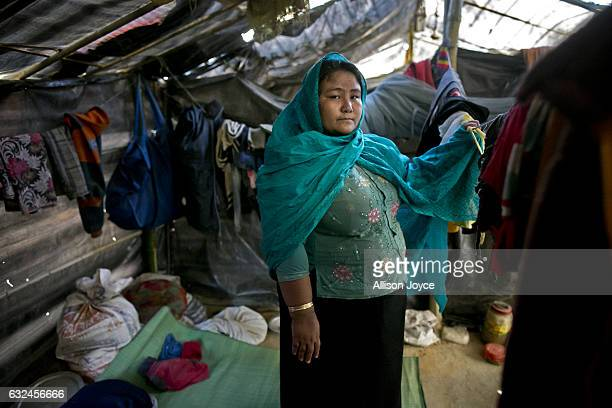 COX'S BAZAR BANGLADESH JANUARY 20 Nurjahan poses for a photo in her makeshift house that she shares with 6 other refugees on January 20 2017 in...