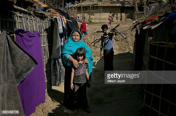 COX'S BAZAR BANGLADESH JANUARY 20 Nurjahan poses for a photo with her daughter outside her makeshift house that she shares with 6 other refugees on...