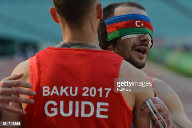 Nurlan Ibrahimov of Azerbaijan celebrates with his guide Vadim Ryabichin the win in Men's 100m T11 final during an athletic event at Baku 2017 4th...