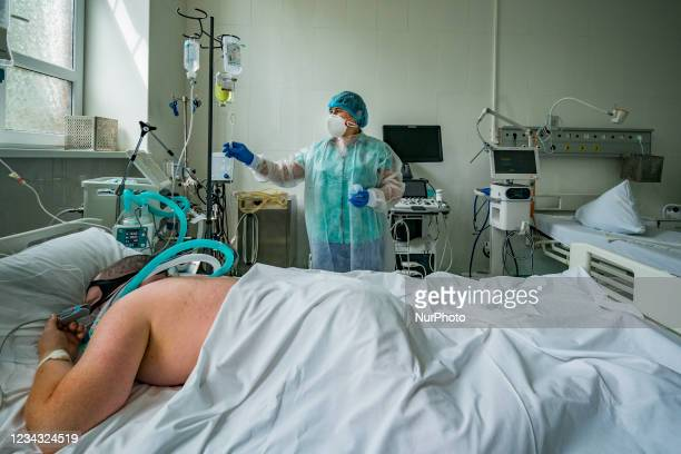 Nurse adjusts the saline solution for a patient with coronavirus in the intensive cares of the Oleksandrivska Clinical Hospital in Kiev, Ukraine.