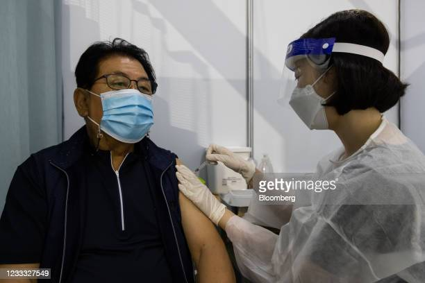 Nurse administers a dose of the Pfizer-BioNTech Covid-19 vaccine at a vaccination site inside the Incheon Samsan World Gymnasium in the Bupyeong...