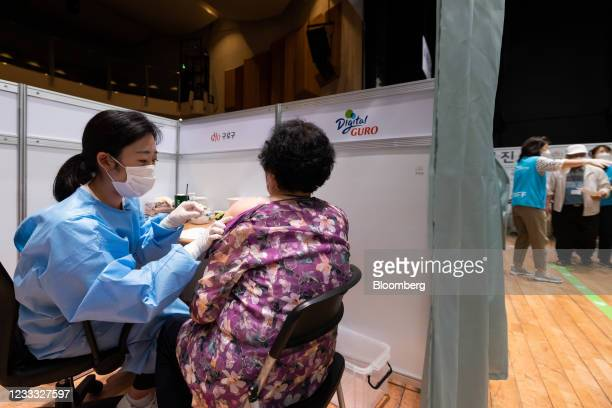 Nurse administers a dose of the Pfizer-BioNTech Covid-19 vaccine at a vaccination site inside the Guro Arts Valley Theater in the Guro district of...