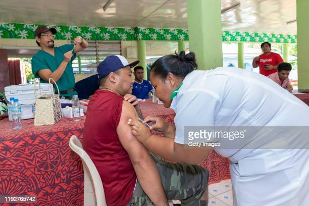 Nurse administers MMR vaccine based on orders on December 6 2019 in Apia Samoa Samoan officials report over 90% of eligible Samoans have been...