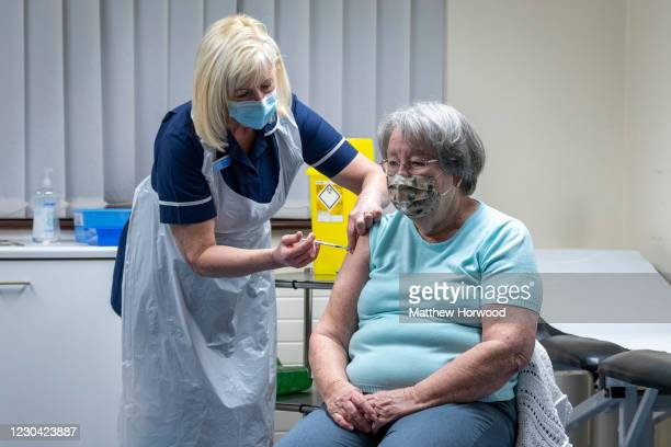 Nurse administers the Oxford-AstraZeneca vaccine to a patient at Pontcae Medical Practice on January 4, 2021 in Merthyr Tydfil, Wales. The...