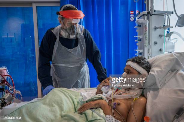 Nurse Adrain Olaru 37, visits his COVID-19 patient Foysal Ahmad 51, at Royal Papworth Hospital on June 15, 2020 in Cambridge, United Kingdom. Ahmed...
