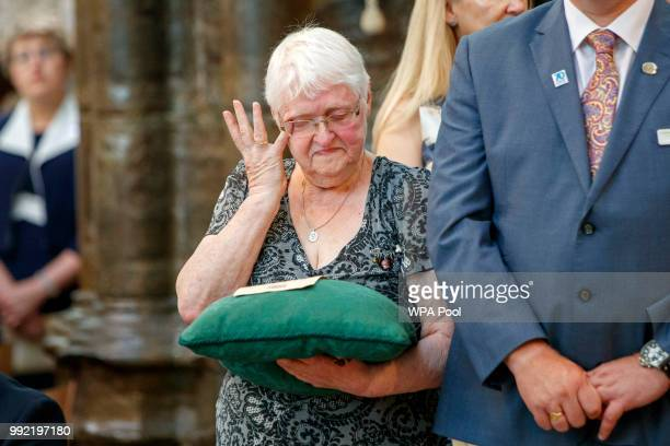 Nurse Aileen Coomber holding a copy of NHS 1948 informational leaflet on a cushion weeps during a service to celebrate the 70th anniversary of the...