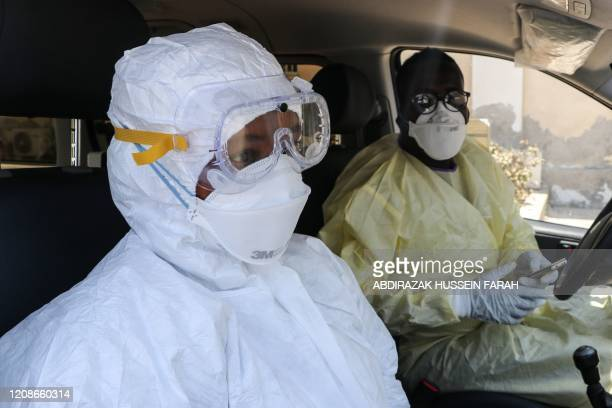 A nurse and ambulance driver wear in protive gears wait for emergency response for suspected patient of the COVID19 coronavirus at Martini hospitalin...