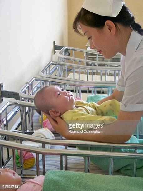CONTENT] Nurse and baby in the Triplets ward of the Pyongyang Maternity Hospital