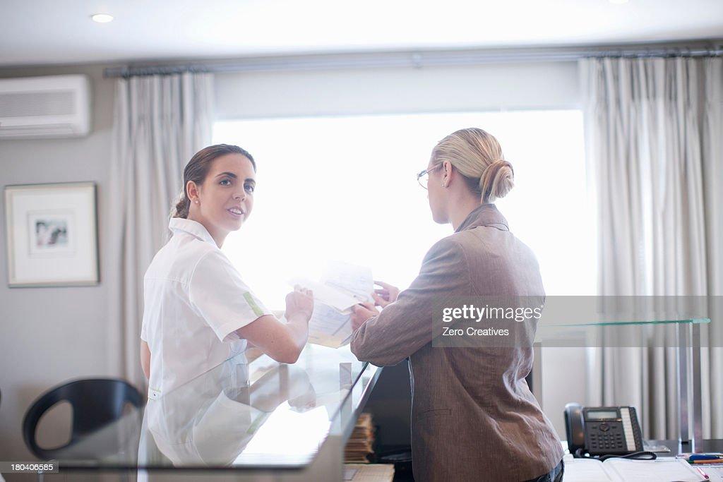 Nurse and hospital receptionist : Stock Photo
