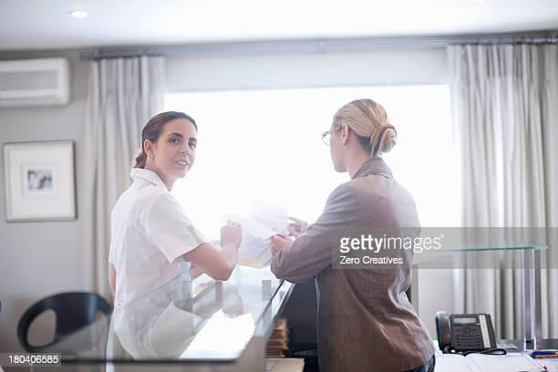 Nurse and hospital receptionist