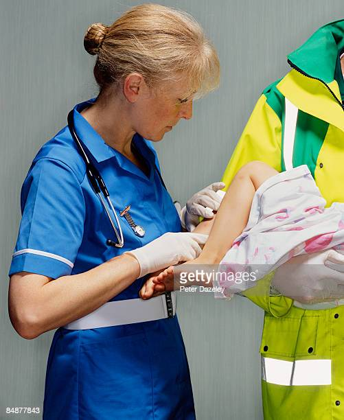 Nurse and paramedic with child.