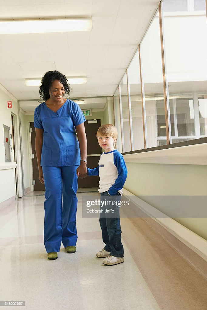 Nurse and patient in hospital corridor : Stock Photo