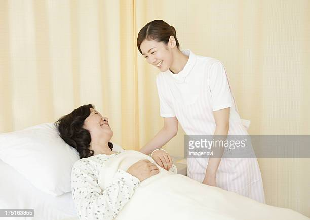 Nurse and patient smiling