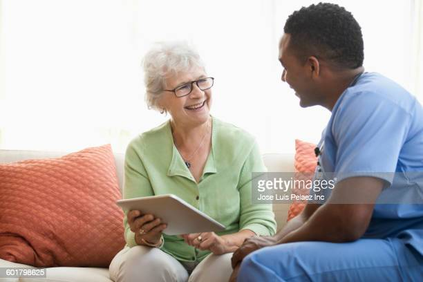 Nurse and patient using digital tablet