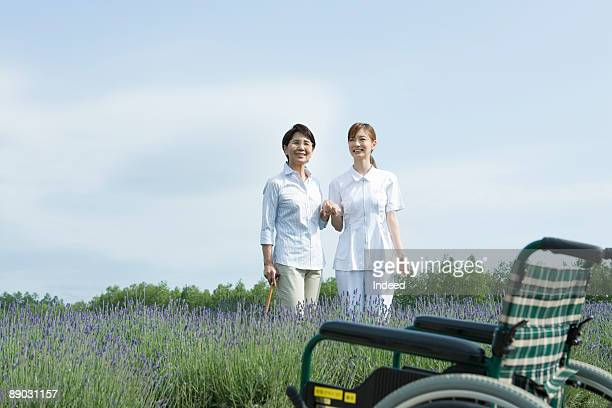 Nurse and Woman standing in a field of lavender.
