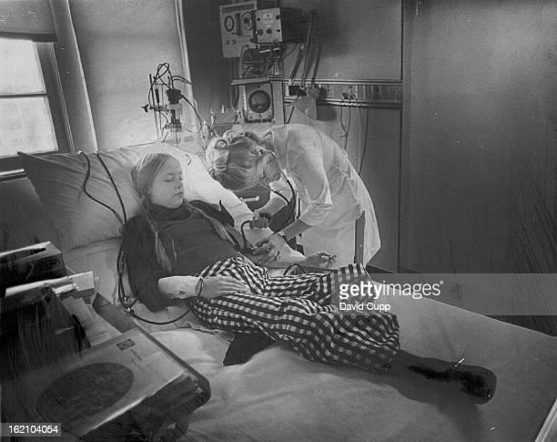 FEB 9 1973 FEB 10 1973 FEB 11 1973 Nurse Ann Bobal Takes Blood Pressure of Robyn Richey Robyn was in Veterans Administration Hospital for dialysis...