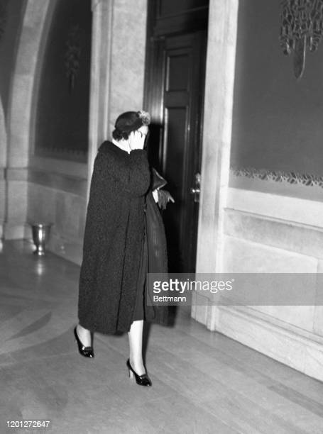 Nurse Anna Green, assistant to Dr. George Harley, is shown entering the Newark court where she and the doctor are co-defendants on trial for...