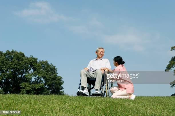 Nurse assisting patient in wheelchair