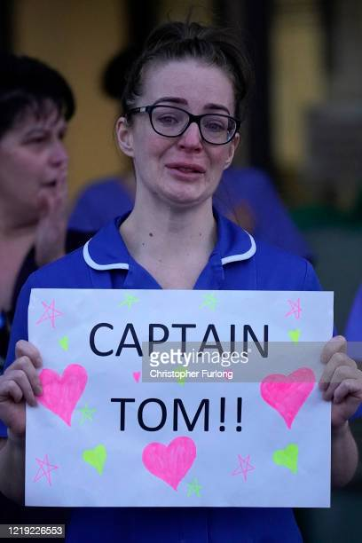 A nurse at Aintree University Hospital sheds a tear and as she pays tribute to super fundraiser Captain Tom Moore during the Clap for Our Carers an...
