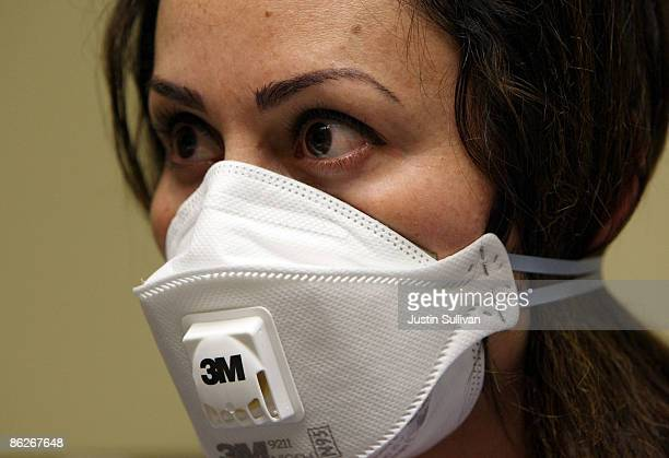 A nurse at the La Clinica San Antonio Neighborhood Health Center wears a N95 respiratory mask during a training session April 28 2009 in Oakland...