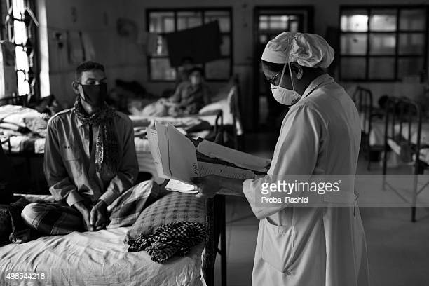 A nurse at the National Institute of Diseases of Chest and Hospital is checking out the medicine for a patient Tuberculosis is a worldwide public...