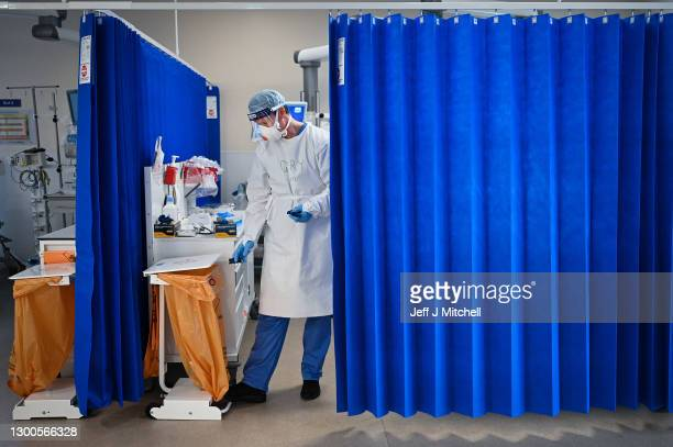 Nurse at University Hospital Monklands disposes of medical waste on the ICU ward on February 5, 2021 in Airdrie, Scotland. The numbers of patients...