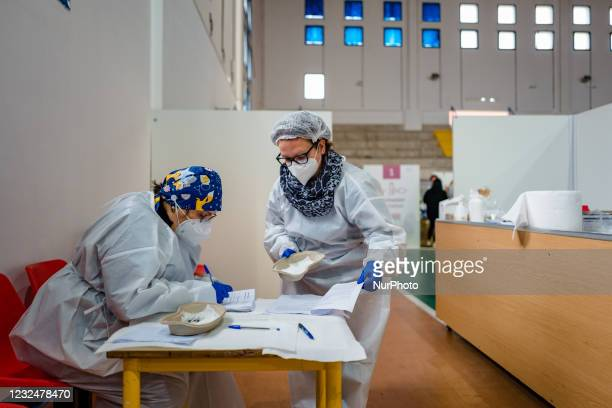 Nurse at work before administering the vaccine to people over 70, on the first day of opening of the Palachicoli in Terlizzi on 23 April 2021. The...