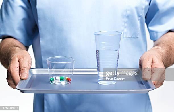 Nurse bringing medication