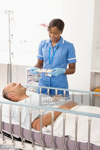 A nurse bringing medication to a patient