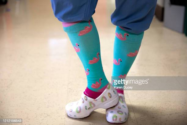 Nurse Britt Fargo shows off her pink flamingo 'covid socks' at Harborview Medical Center on May 7 2020 in Seattle Washington Medical staff have been...
