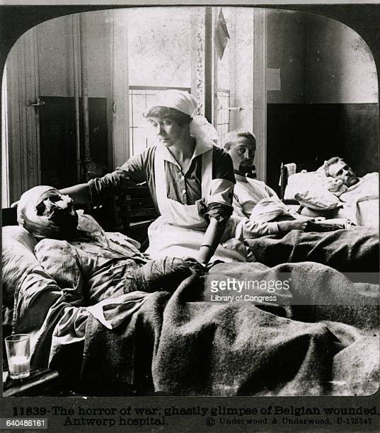 A nurse cares for a badly wouded Belgian soldier in an Antwerp hospital during World War I ca 1915