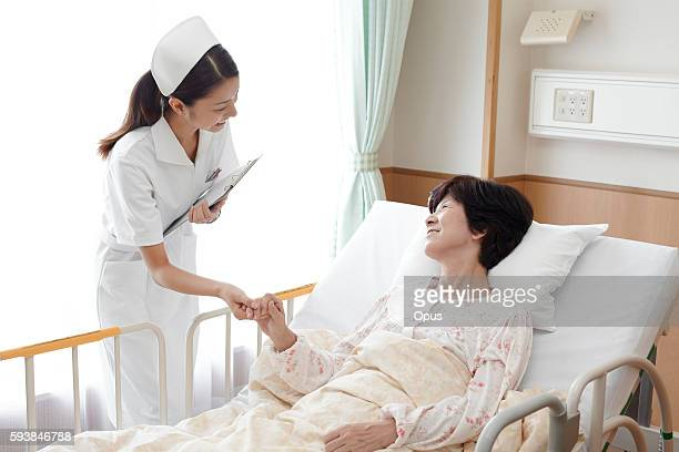 Nurse Caring For Female Patient
